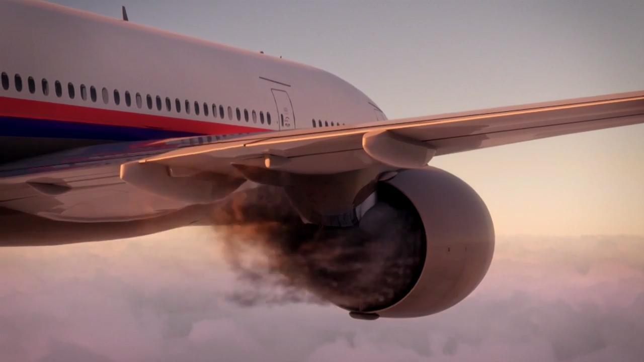 نمایی از موتور خراب شده ی هواپیما در آسمان